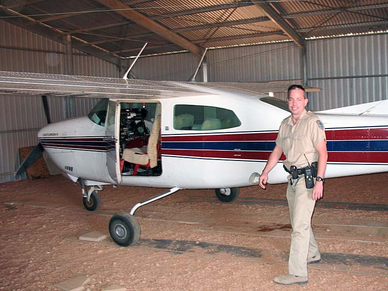 Local police officer in Coober Pedy investigating the break-in to the Opal Air hangar and the theft of their tow vehicle.