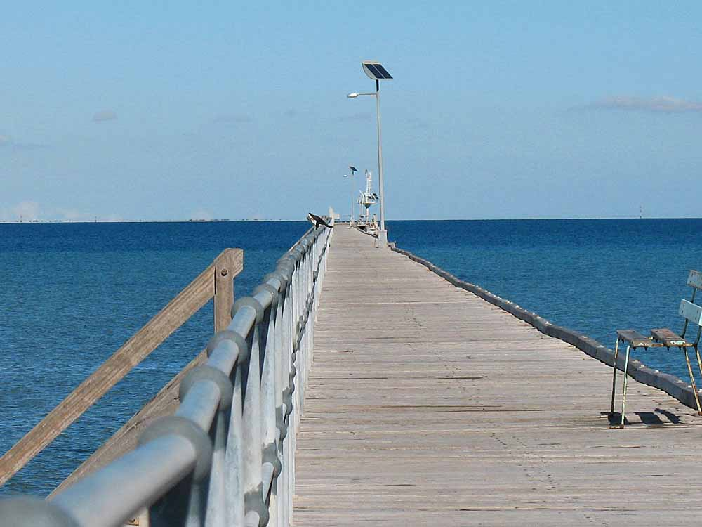 Long wooden pier at Port Germein.  It seemed as if this pier was about a mile in length...but it was a beautiful day and with the fresh salt air and seabirds nearby it was a great walk.