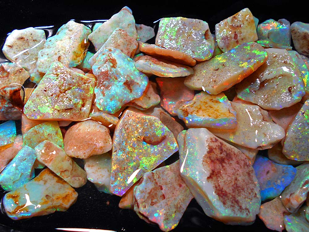 This retirement opal is a miners personal stash that he has put away for his golden years.  I didn't look closely, but there may be upwards of  $75,000 or more of gem opal here...just a pleasure to see.