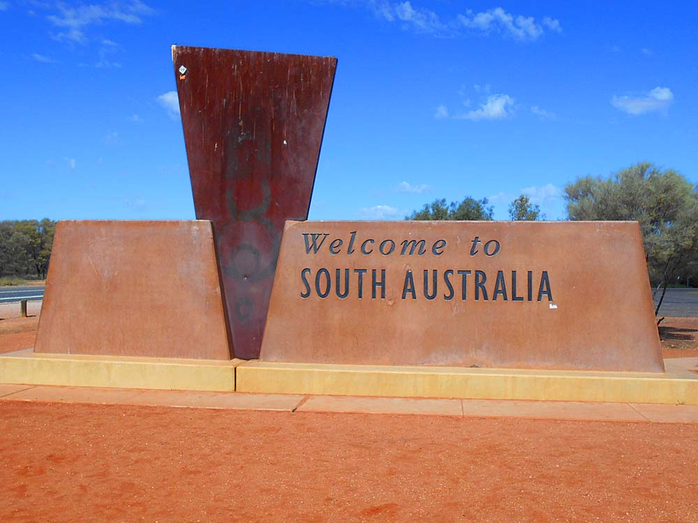 Welcome sign for the traveler when crossing into South Australia from the Northern Territory.  I'm only a few hours from Coober Pedy and can almost smell rough opal.