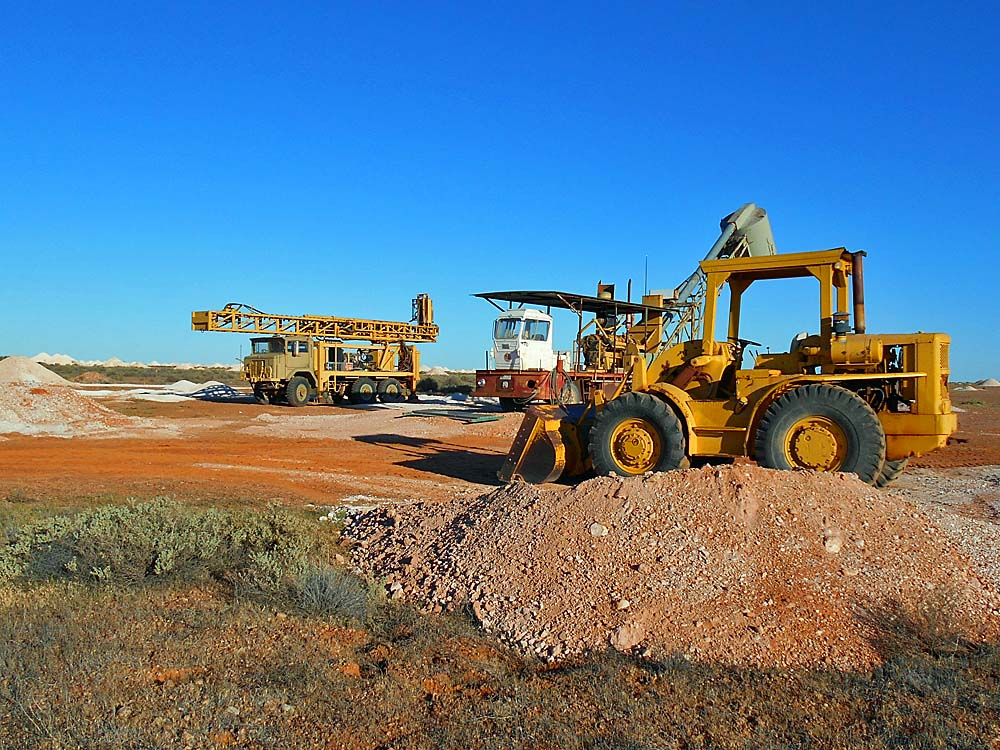 Lots of extremely expensive equipment is necessary for a productive opal mine today.  Tim and Sam Seekamp's mine at Olympic Field in Coober Pedy.