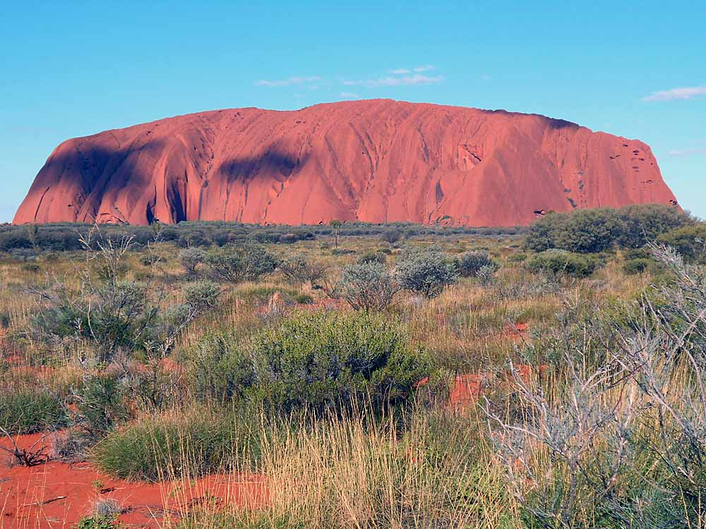 Uluru...majestic sandstone monolith in the center of Australia...considered sacred by the local Pitjantjatjara aboriginal peoples.